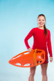 Girl lifeguard with equipment float Stock Image