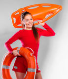Girl lifeguard with rescue equipment Royalty Free Stock Image