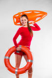 Girl lifeguard with rescue equipment Royalty Free Stock Photo