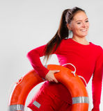 Girl lifeguard with rescue equipment Stock Image