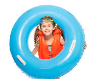 A girl in lifejacket and goggles with rubber ring Stock Images