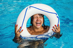 The girl with the Lifeline has fun in the pool Stock Photo