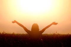 Girl lift her hands to the sky and feel freedom. Royalty Free Stock Images