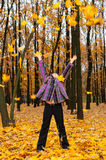 The girl with the lifted hands autumn forest Stock Photo