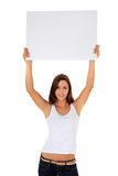 Girl lifting blank white sign Stock Photos