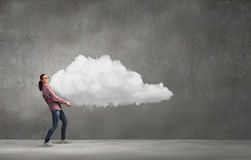 Girl lifting cloud Royalty Free Stock Image