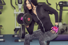 Girl lifting a dumbbell Stock Photos