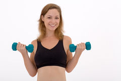 Girl lifting a weight Stock Image