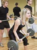 Girl lifting weights Stock Photo