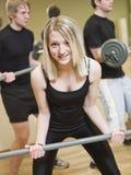 Girl lifting weights Stock Photos