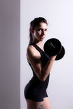 Girl lifting weights Stock Images