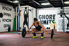 Girl is lifting weights on training. In gym Stock Photo