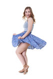 Girl lifts up dress. Girl lifts dress in the studio on a white background Royalty Free Stock Photos