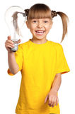 Girl with light bulb Royalty Free Stock Images