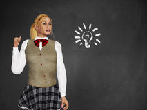 Girl with light bulb on blackboard Royalty Free Stock Images