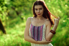 Girl in a light dress in the forest. Royalty Free Stock Photography