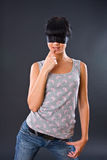 The girl in a light vest with the eyes fastened by Stock Photography