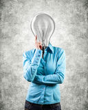 Girl with a lightbulb Royalty Free Stock Image