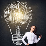 Girl with lightbulb sketch Royalty Free Stock Photo