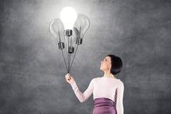 Girl with lightbulbs Stock Photo