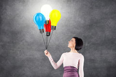 Girl with lightbulbs Royalty Free Stock Images