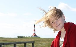 Girl and lighthouse Stock Photos