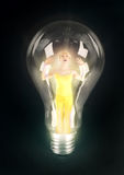 Girl lighting in bulb Stock Images