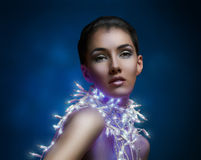 Girl in the lights Stock Photography