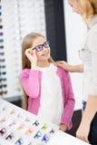 Girl like blue framework for glasses Royalty Free Stock Image