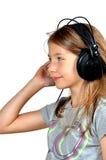 Girl like Music  headphones Royalty Free Stock Photo