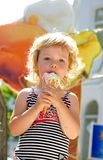 Girl likes ice cream Stock Image