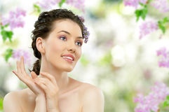 Girl with lilac Royalty Free Stock Images