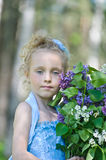 Girl with lilac Stock Image