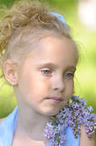 Girl with lilac Stock Images