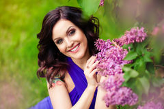 The girl in the lilac bushes Royalty Free Stock Images