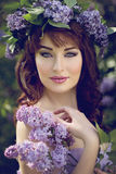 Girl with lilac Royalty Free Stock Photo