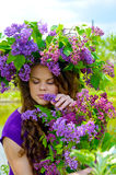 Girl with lilac flowers Stock Photo
