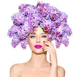 Girl with lilac flowers hairstyle Stock Photo