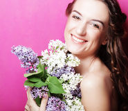 Girl with  lilac flowers over pink background Royalty Free Stock Photo