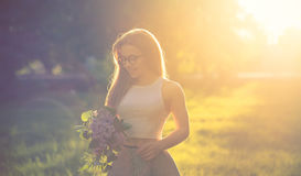 Girl with lilac flowers Royalty Free Stock Photos