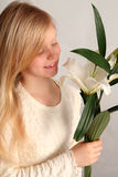 Girl and lilies Stock Photography