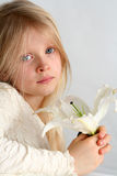 Girl and lilies Royalty Free Stock Photography