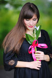 Girl with lilies of the valley in the spring royalty free stock photos