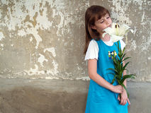 Girl and lilly Royalty Free Stock Photography
