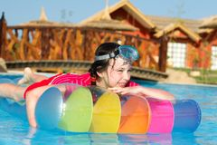 Girl on lilo in pool Royalty Free Stock Image