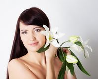 Girl with lily Royalty Free Stock Photos