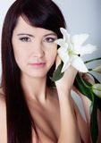 Girl with lily Stock Image