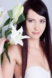 Girl with lily Royalty Free Stock Image