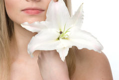 Girl with lily Stock Images
