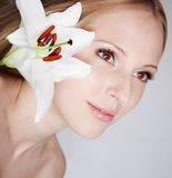 Girl with lily flower Stock Photo